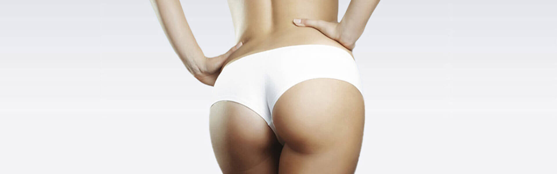 Picture of a woman wearing a white bathing suit depicting plastic surgery in San José, Costa Rica.